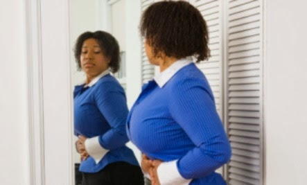 Website Says Women Overestimate Waist Size - black working woman mirror dressing room outfit