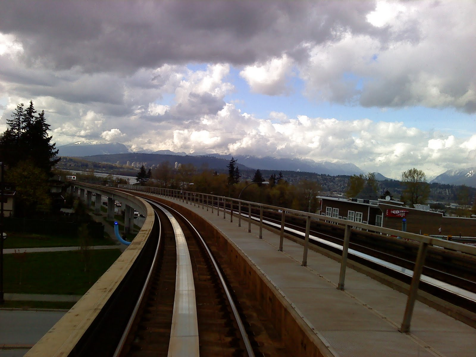 essay eh skytrain views early mid and late spring the background view is of the north shore mountains beyond the fraser river the city and burrard inlet