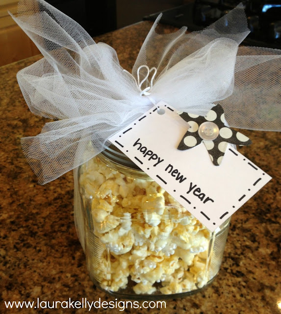 http://www.laurakellydesigns.com/laurakellydesignsblog/index.php/2013/12/13/celebration-sparkle-popcorn-treat/