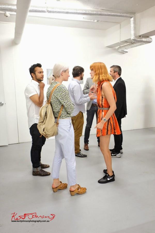 Orange hair orange dress, nike runners, Chalk Horse Gallery