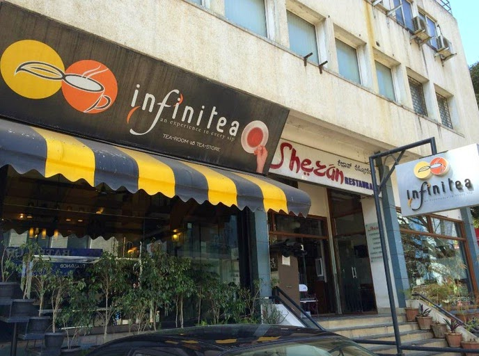 Cafe interior design of infinitea in bangalore india for Cafe design exterior