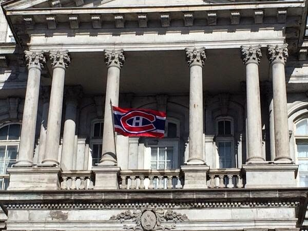 Montreal City Hall with a Habs flag flying outside