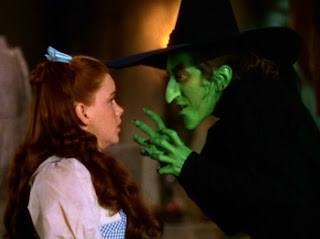 Judy Garland as Dorothy Gale and Margaret Hamilton as the Wicked Witch of the West in THE WIZARD OF OZ