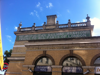 Ghost sign on Gloucester Road tube station, London