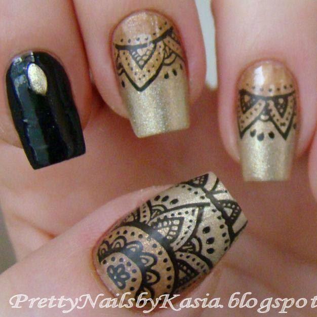 http://prettynailsbykasia.blogspot.com/2015/01/karnawaowy-manicure-w-kolorach-zota-i.html