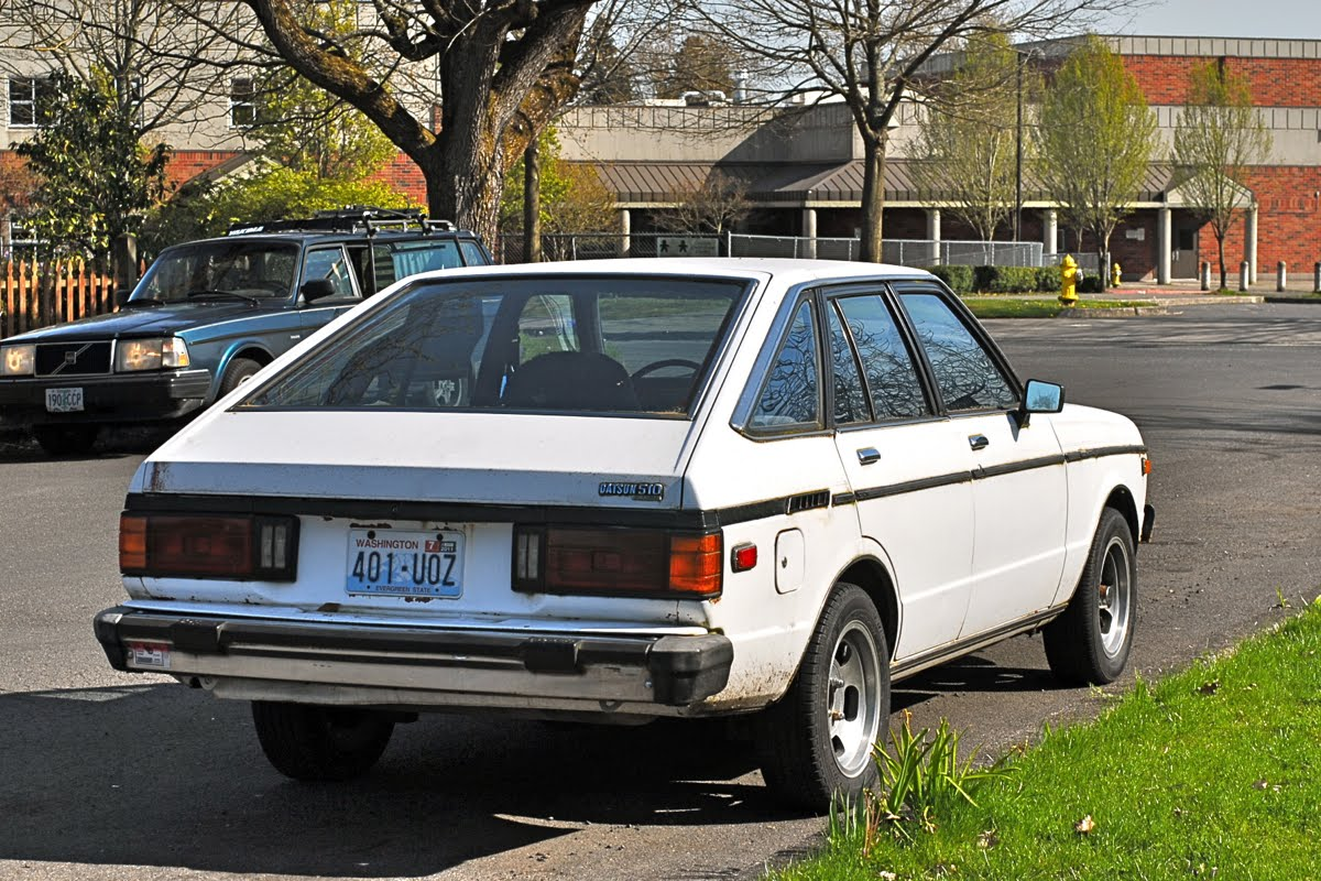 OLD PARKED CARS.: 1981 Datsun 510.