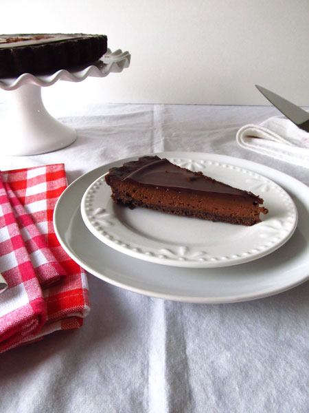 A piece of decadent chocolate tart