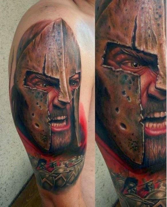 tattoo guerreiro no braço