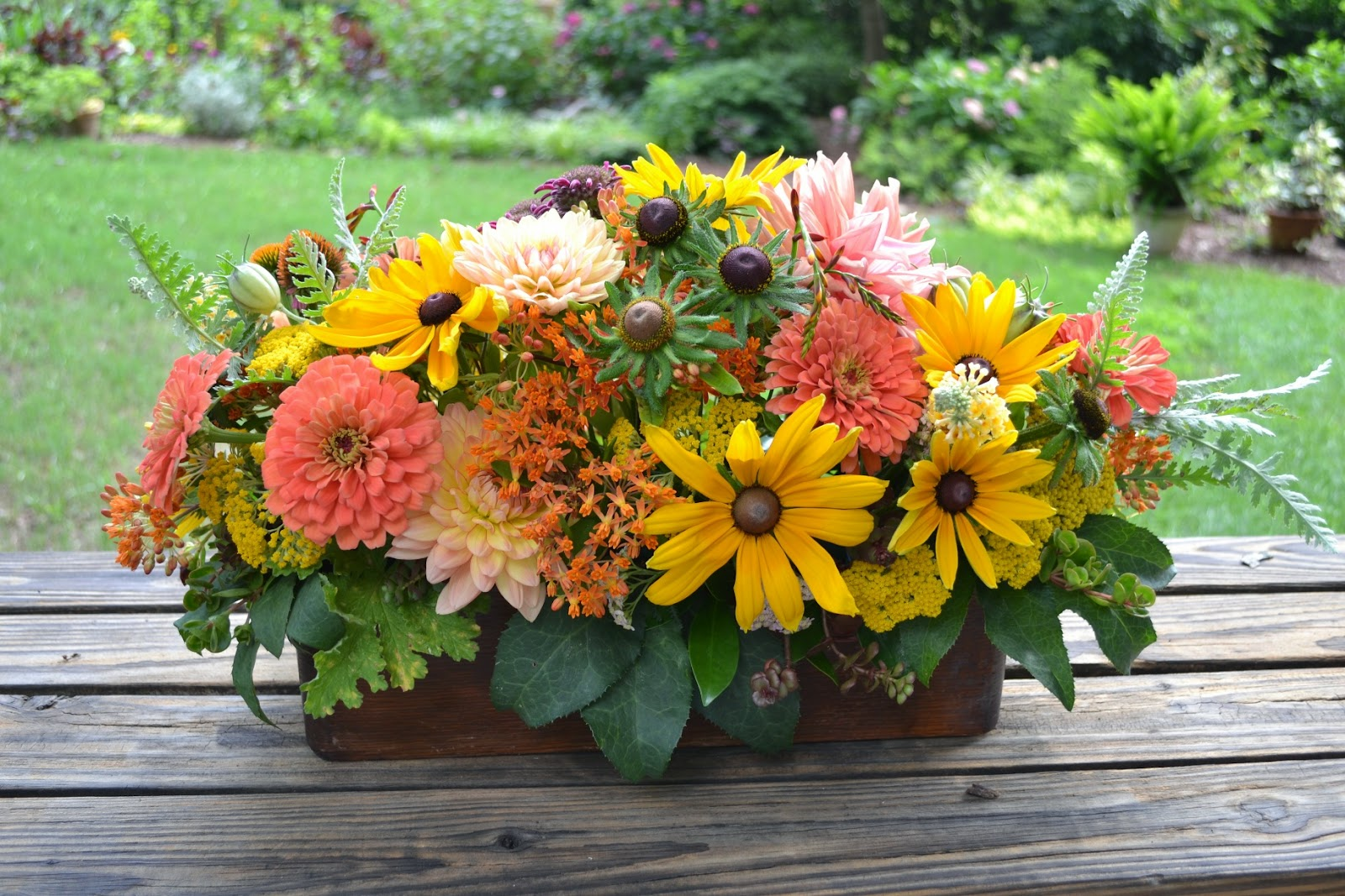 Wedding Flowers from Springwell Peach Dahlias and Zinnias with Black Eyed Su