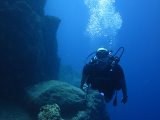 Noah diving along the donkey trail inside the Santorini caldera.