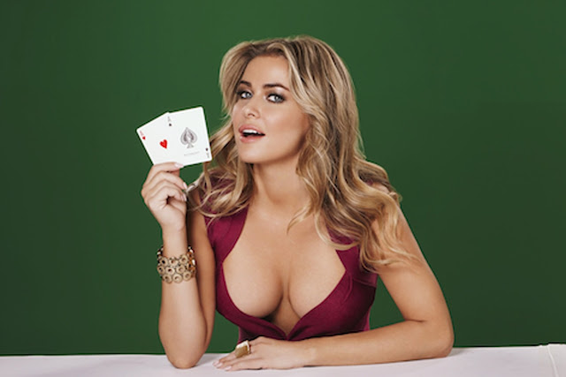 Carmen Electra gravity defying cleavage in this promo for her new role as the face of Pokerist.com