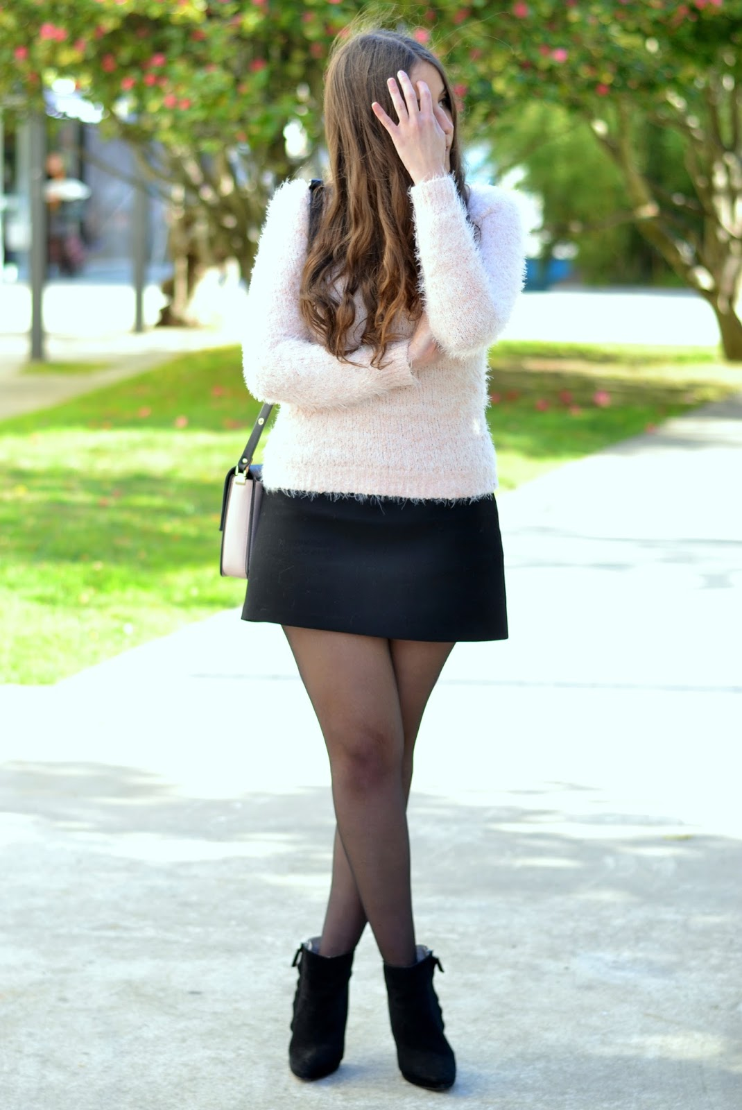 pink sweater and black skirt