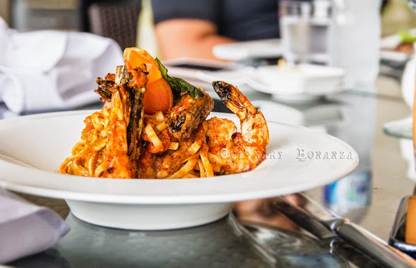 King Prawn Linguini - tossed in pesto tomato concasse, with kalamata olives served with grilled king prawns