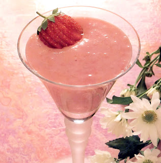 Strawberry cloud: classic vegen dessert of strawberry puree in a tofu base served in a glass and garnished with a whole srawberry