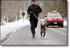 Picture of man running with dog whs