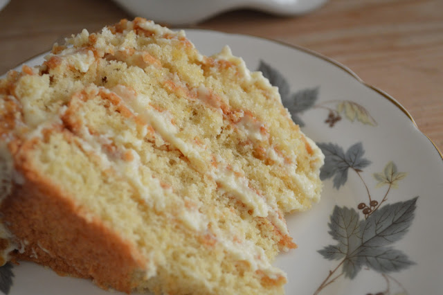 gingey bites A slice of white chocolate, lemon and macadamia Genoise layer cake