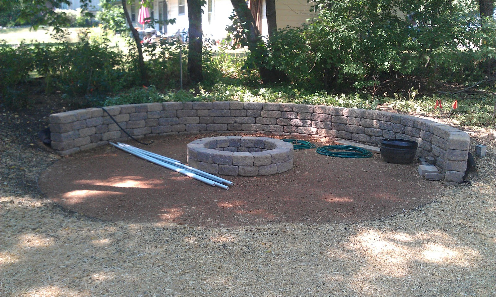 Grading landscaping paver patios retaining walls and for Gravel around fire pit
