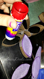 gluing tissue paper on toilet paper roll butterrfly