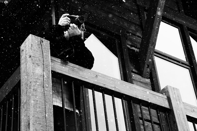 A wedding photographer shooting a ceremony from a balcony in Breckenridge, Colorado.