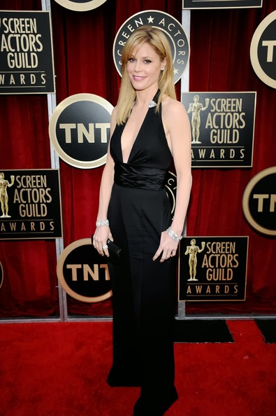Julie Bowen in a plunging black Catherine Malandrino halter jumpsuit with a pair of diamond pins in the neckline at the 17th Annual Screen Actors Guild Awards held at The Shrine Auditorium on January 30, 2011 in Los Angeles, California.