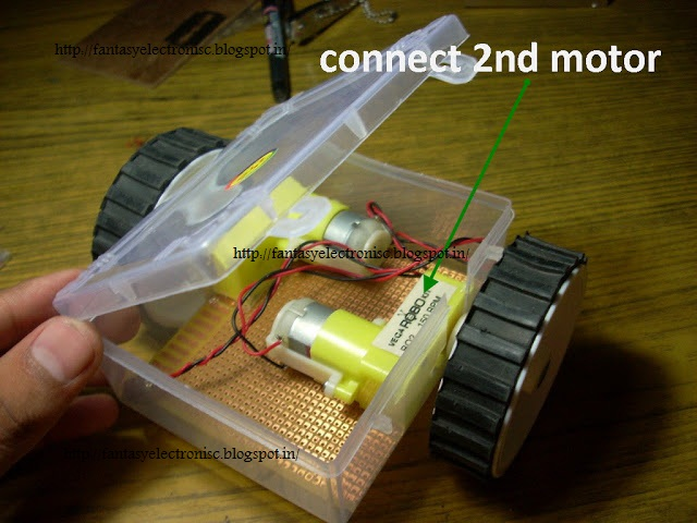line following robot or line Line Tracker using ATtiny2313  with complete project report, code and circuit diagram.