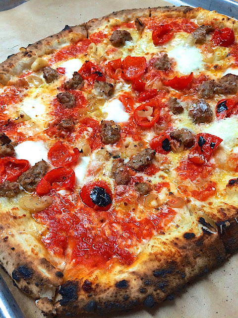 San Genarro Pizza from Antico in Atlanta, GA - topped with salsiccia, sweet red pepper, bufala and cipolline