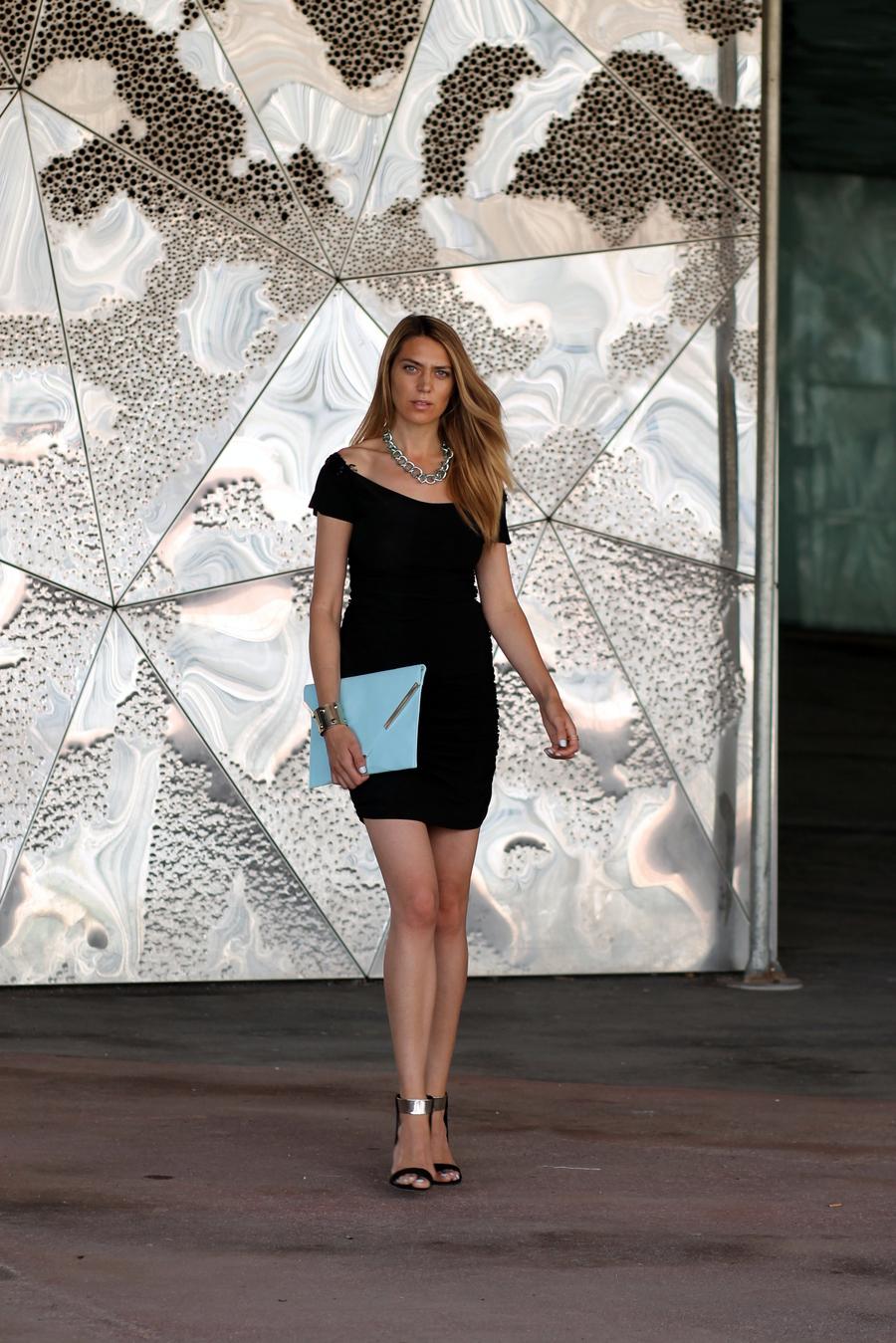 Blonde model with black short dress