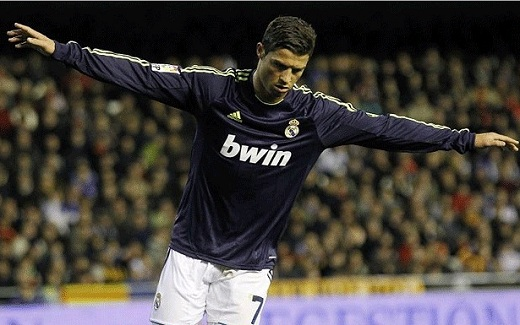 Cristiano celebrates a goal with the dark Real Madrid jersy