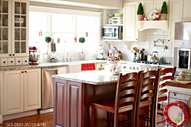 Cherry island with white cabinets, farmhouse sink kitchen-www.goldenboysandme.