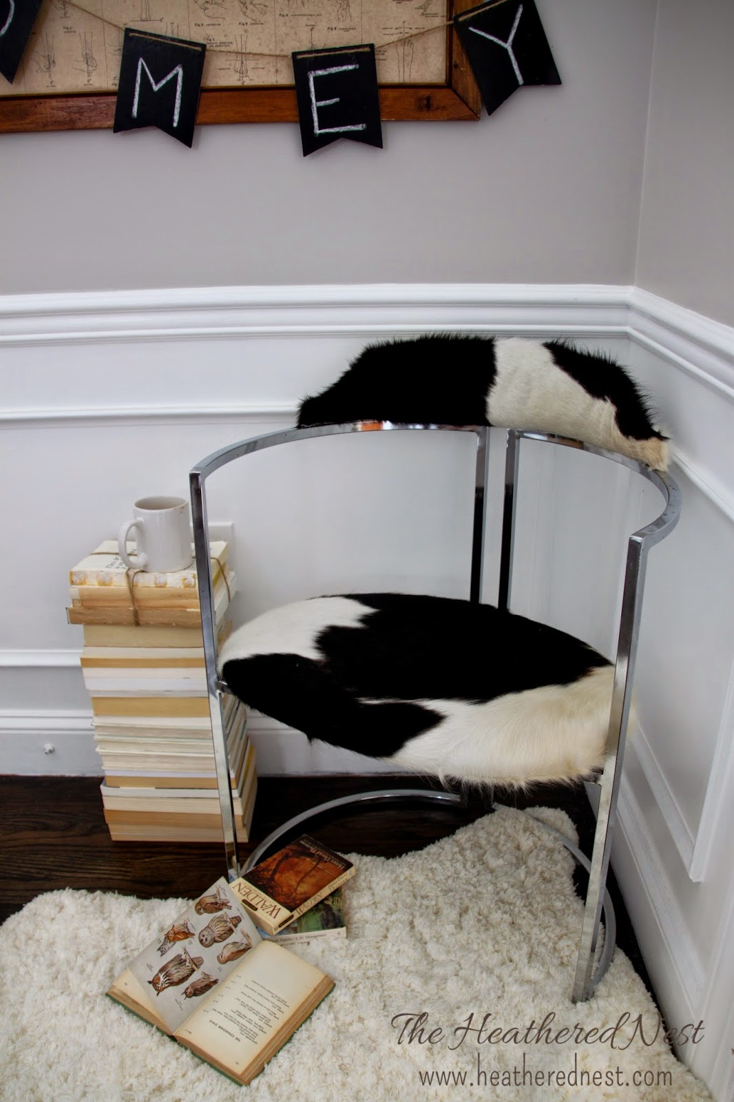 Easy tips for reupholstering with cowhide from the Heathered Nest
