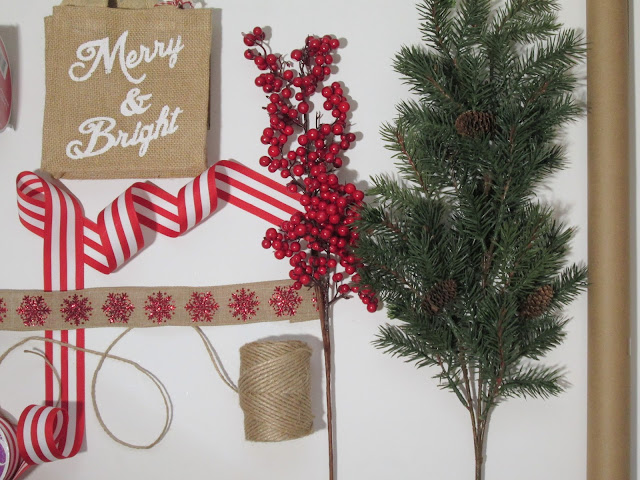 Gift wrap theme with tree sprigs, striped ribbon, berries, twine and brown paper