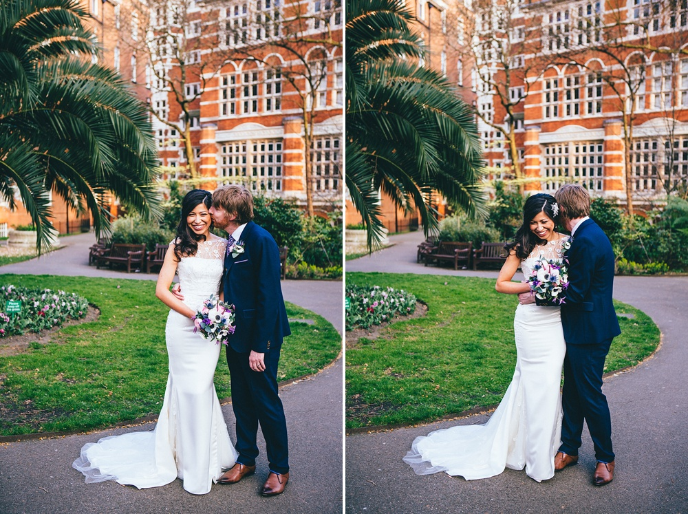 James and Tina bride and groom portraits by Mayfair Library in Central London cute and happy bride smiles as her groom kisses her.