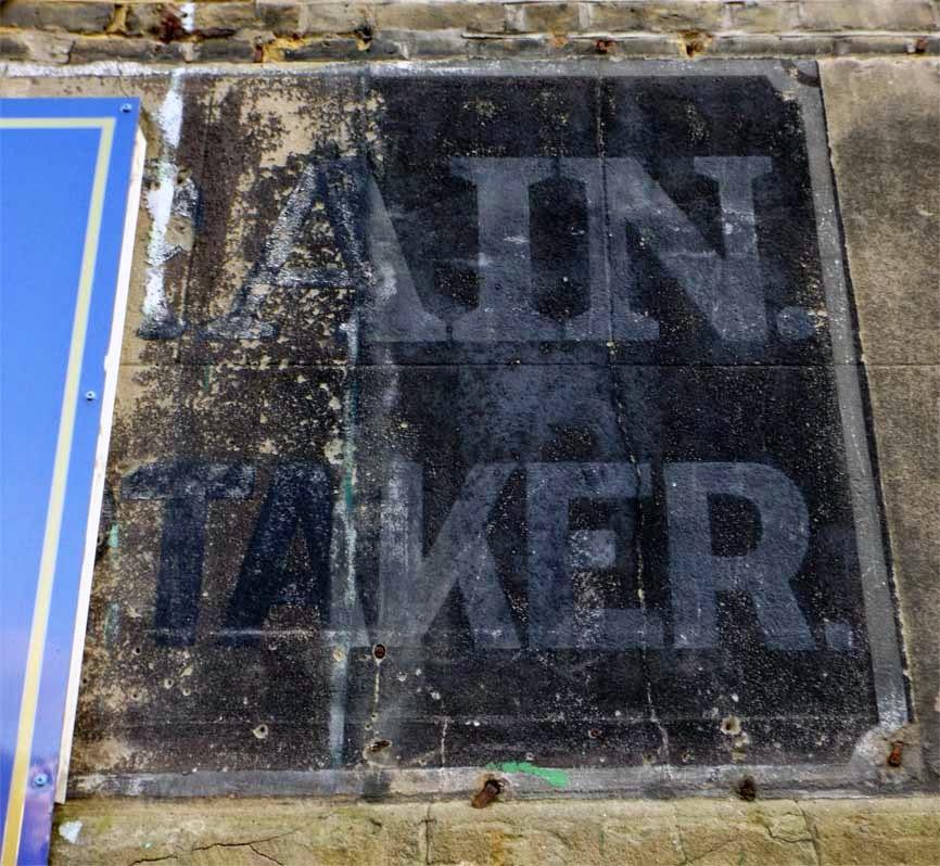 undertaker ghost sign clock clinic putney