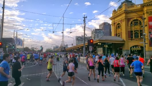 Turning into Swanston Street in front of Flinders Street Station