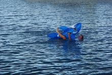Cheryls unsuccessful attempt to ride a blow up dolphin 