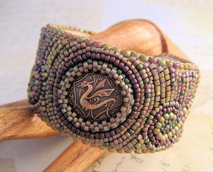 Bead embroidery dragon bracelet by Sherri Stokey.