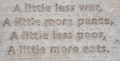 Poem stamped in concrete, reading