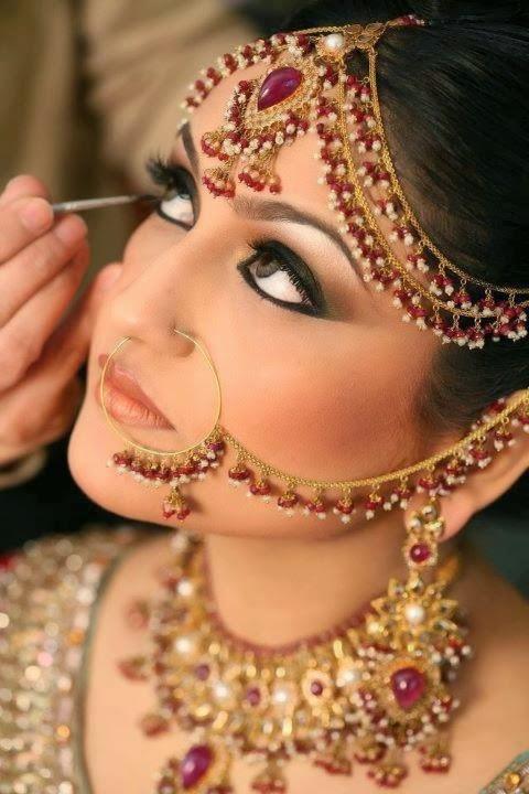 Kohl (Anjana or Kajal) application in bride's eyes
