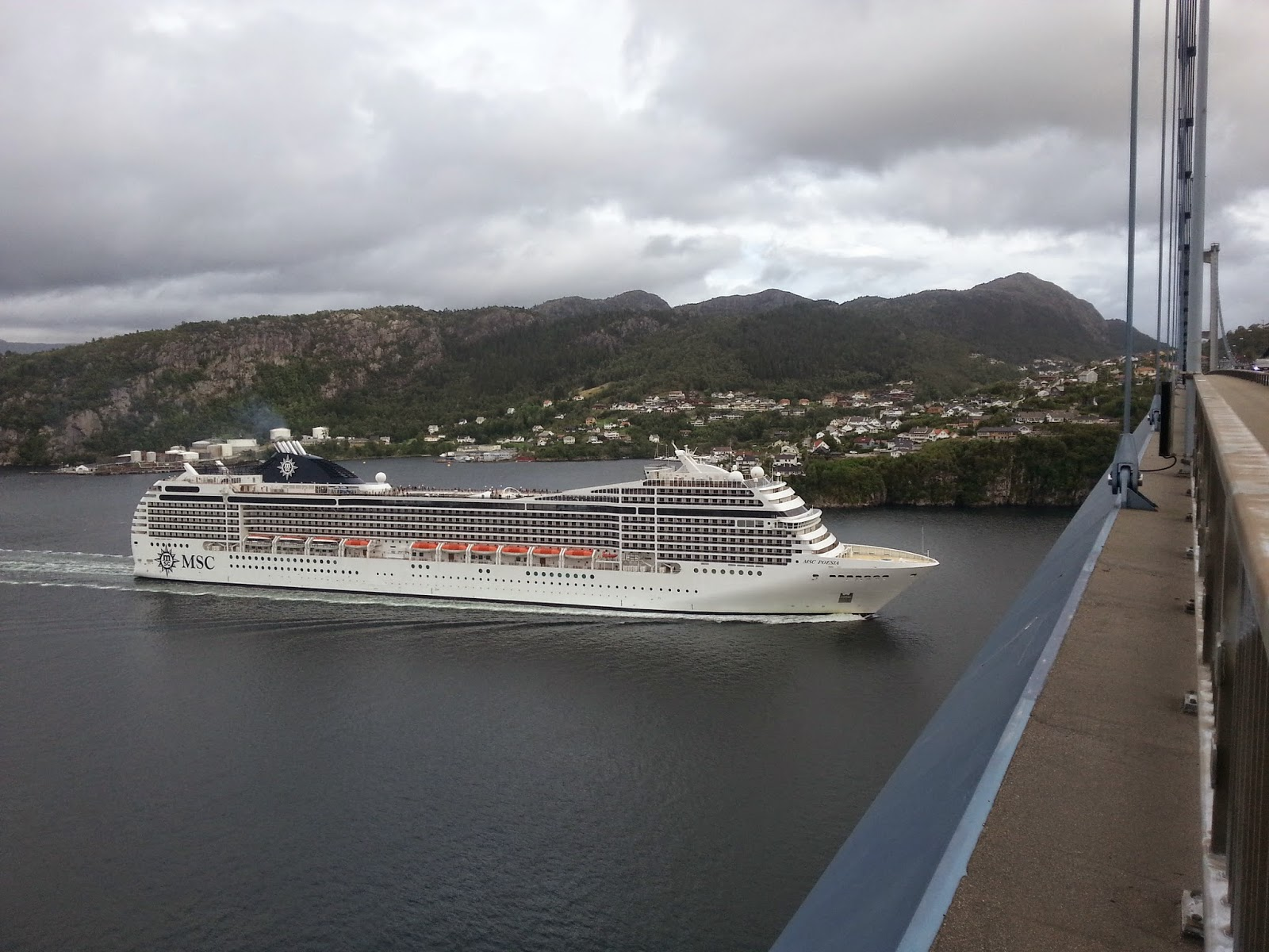 Cruise Ship MSC Poesia passes under the Askøy Bridge, Bergen