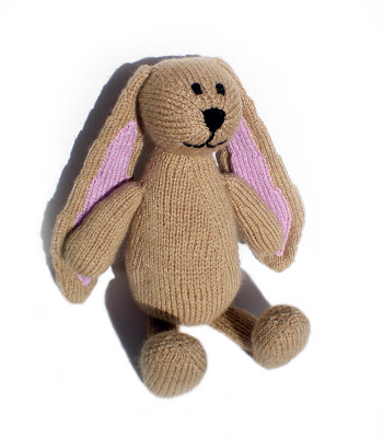 a fancy beige knitted plush bunny or rabbit called humboldt