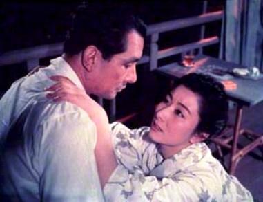 男の手が最近接した女の姿形に自然に伸びて、運命づけられたように二人は結ばれたのである。 「深紅」