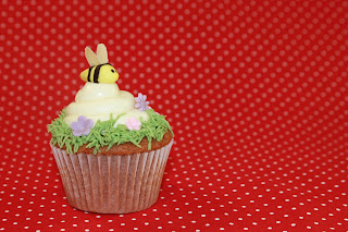 Honey and lemon cupcake topped with honey and lemon buttercream and a fondant bee