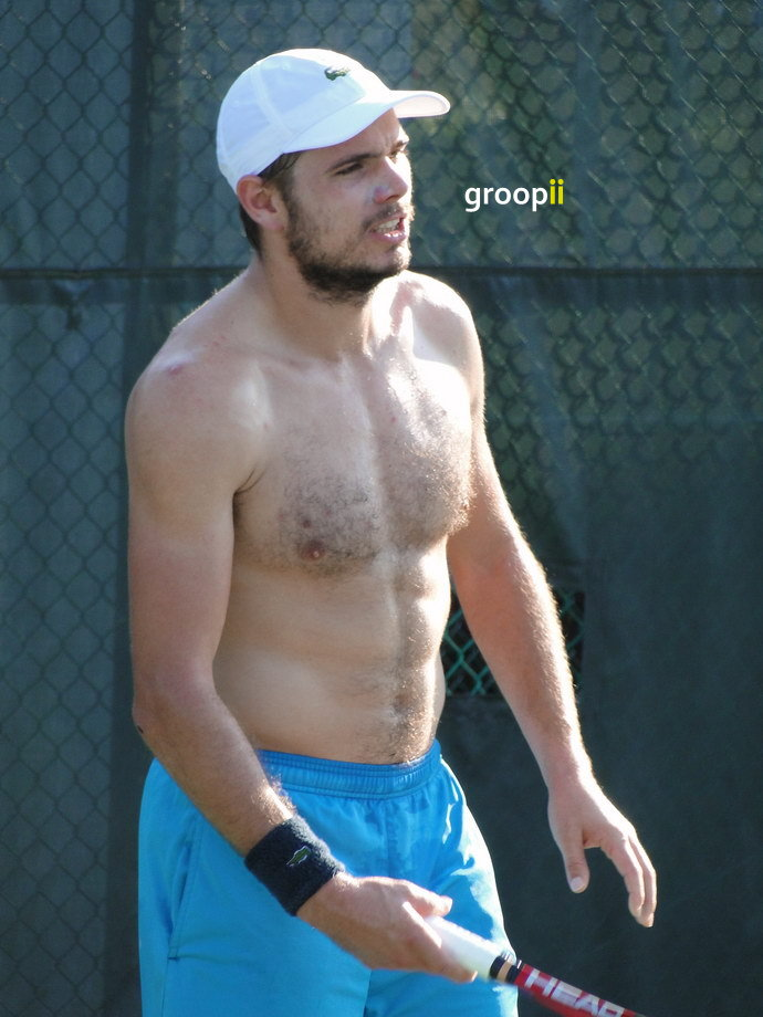 Stanislas Wawrinka from Swiss was shirtless on the practice court at...