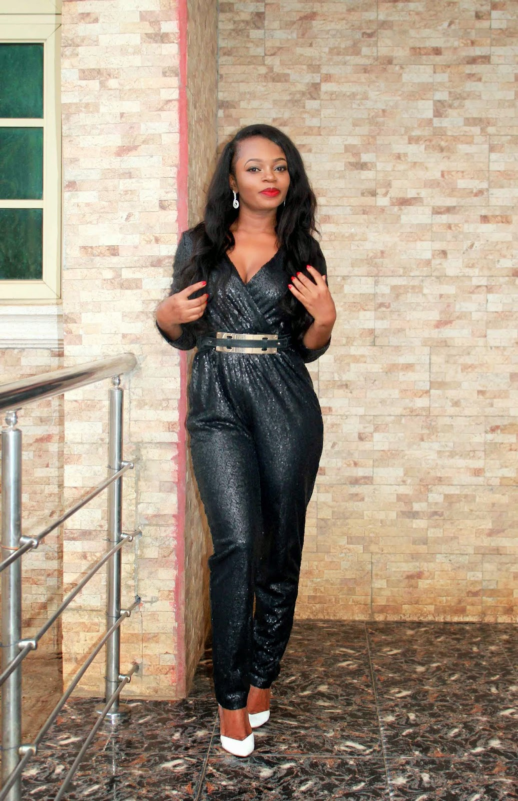 black sequin jumpsuit with white court shoes