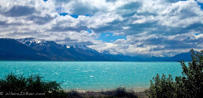 Mt. Cook in the distance, new zealand, panorama, lake, blue water, snow covered peaks,
