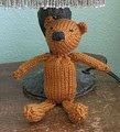http://www.ravelry.com/patterns/library/henri-the-knitted-bear