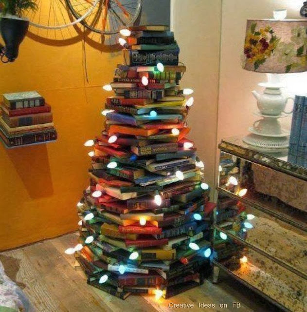 http://twentytwowords.com/2011/12/12/a-christmas-tree-made-of-stacked-books/