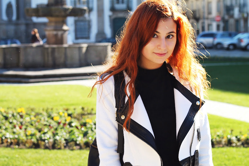 red hair blogger smiling with Chicwish black and white jacket