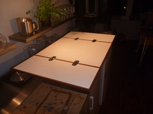 Opened tabeltop for Lagun table. Teak fiddle rails, WISA Multiwall surfaces, and chrome counterflap hinges.