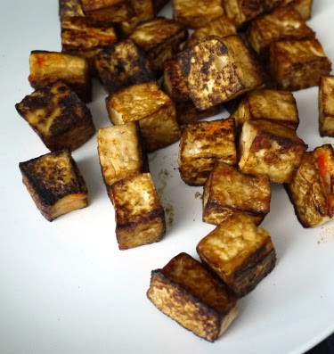 browned tofu cubes with soy sauce and sriracha
